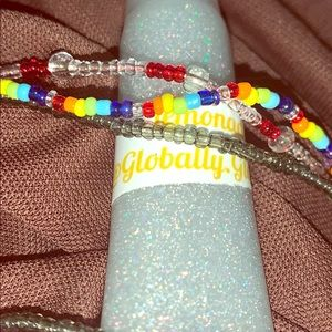 gloss bags (2 lipgloss 2anklets and a hair clip)